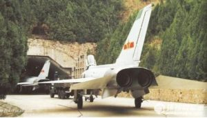 Chinese jet fighters at entrance of an underground air base