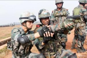Chinese soldier teaching Indian soldiers to use type 92 pistol